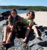 photo:  Newfoundland pup Zoey with Jessica,and Shelby